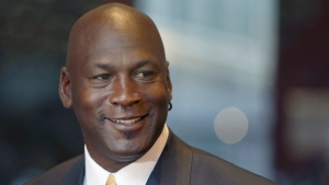 In this Aug. 21, 2015, file photo, former NBA star Michael Jordan smiles at reporters in Chicago. (AP Photo/Charles Rex Arbogast)