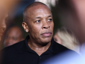 "In this Aug. 10, 2015, file photo, Dr. Dre arrives at the Los Angeles premiere of ""Straight Outta Compton."" (Photo by John Salangsang/Invision/AP)"