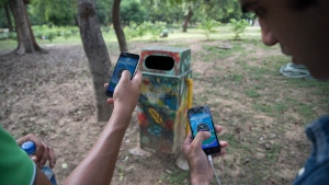 In this Friday, July 22, 2016. photo, random 'pokestops' are deployed in the game Pokemon Go for players to gather Pokeballs and goodies, in Lodhi garden, New Delhi, India.  (AP Photo/Thomas Cytrynowicz)