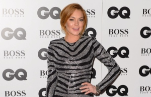 In this file photo, Lindsay Lohan arrives for the GQ Men Of The Year Awards 2014 at a venue in central London. (Photo by Jonathan Short/Invision/AP, File)