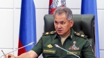 In this photo provided by the Russian Defense Ministry press service, Russian Defense Minister Sergei Shoigu speaks in the Defense Ministry headquarters in Moscow on Thursday, July 28, 2016. Shoigu says Moscow is sending a top general and experts to Geneva at request of U.S. Secretary of State John Kerry to discuss the crisis surrounding the embattled Syrian city of Aleppo. (Russian Defense Ministry Press Service photo via AP)