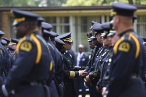 Detroit Police Chief James Craig shakes the hands of Dallas law enforcement officers at the funeral service for slain officer Michael Krol in Redford Township, Mich., Tuesday, July 19, 2016. Hundreds of officers from Texas and across Michigan gathered in suburban Detroit for a funeral for Krol, who was among five officers killed this month in Dallas. (Tanya Moutzalias/The Ann Arbor News-MLive.com Detroit via AP)