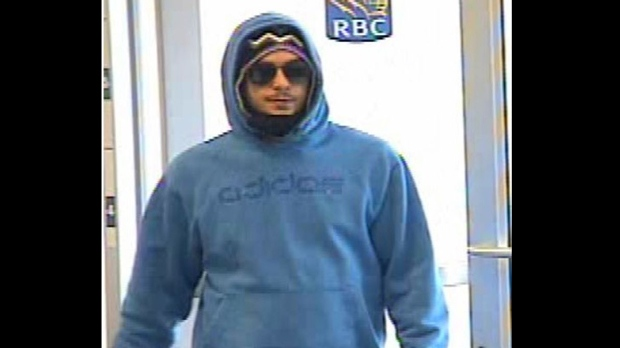 A suspect wanted in relation to five bank robberies is seen in a surveillance camera image. (Toronto Police)