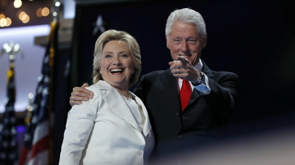 Democratic presidential nominee Hillary Clinton is joined by her husband Former President Bill Clinton after addressing the delegates during the final day of the Democratic National Convention in Philadelphia on Thursday, July 28, 2016. (AP / Carolyn Kaster)