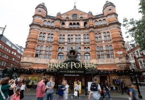 In this photo taken on Thursday, July 28, 2016, the Palace Theatre in London shows advertising for the new Harry Potter play. (AP Photo/Kirsty Wigglesworth)