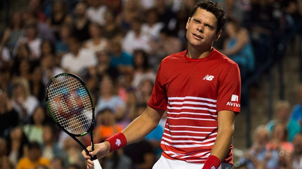 Milos Raonic of Canada reacts while playing against Gael Monfils of France during men's quarter-final Rogers Cup tennis action in Toronto on Friday, July 29, 2016. THE CANADIAN PRESS/Nathan Denette