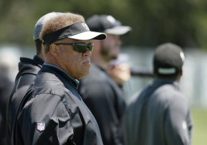 Oakland Raiders general manager Reggie McKenzie watches the team's NFL football minicamp Wednesday, June 15, 2016, in Alameda, Calif. (AP Photo/Eric Risberg)