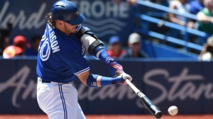 Toronto Blue Jays' Josh Donaldson hits a single during third inning MLB baseball action against the Baltimore Orioles, in Toronto on Saturday, July 30, 2016. THE CANADIAN PRESS/Jon Blacker