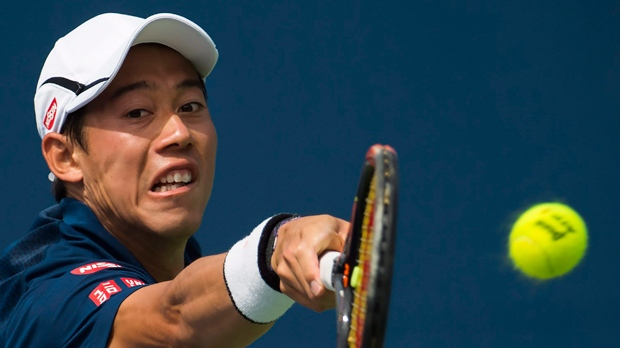 Kei Nishikori of Japan returns the ball against Rajeev Ram of the United States during men's day four Rogers Cup tennis action in Toronto on Thursday, July 28, 2016. THE CANADIAN PRESS/Nathan Denette