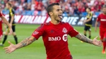 Toronto F.C.'s Sebastian Giovinco reacts to the crowd after he scored his second goal during first half MLS action against Columbus Crew S.C., in Toronto on Sunday, July 31, 2016. THE CANADIAN PRESS/Fred Thornhill