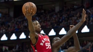 Toronto Raptors guard Delon Wright (55) sails past Minnesota Timberwolves centre Gorgui Dieng during second half NBA pre-season action Wednesday October 14, 2015 in Ottawa. (THE CANADIAN PRESS/Adrian Wyld)