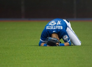 Toronto Blue Jays right fielder Jose Bautista (19) reacts after causing a throwing error after Tampa Bay Rays centre fielder Kevin Kiermaier (39) hit a single during third inning AL baseball action in Toronto on Tuesday, Aug. 9, 2016. (The Canadian Press/Nathan Denette)