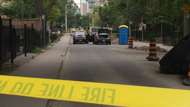 Police officers investigate following a fatal hit-and-run in downtown Toronto on Monday, Aug. 15, 2016. (CP24/Jackie Crandles)
