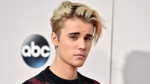 In this Nov. 22, 2015 file photo, Justin Bieber arrives at the American Music Awards at the Microsoft Theater in Los Angeles. (Photo by Jordan Strauss/Invision/AP, File)