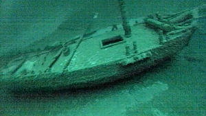 "This July 16, 2016, photo taken from underwater video shows the ""Washington"", which sank during a storm in 1803. The team of underwater explorers says it has found the second-oldest confirmed shipwreck in the Great Lakes, an American-built, Canadian owned-sloop that sank in Lake Ontario 213 years ago. The three-member western New York-based team says it discovered the wreck of the Washington earlier this summer in deep water off Oswego. (Roger L. Pawlowski via AP)"