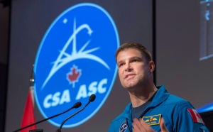 Canadian astronaut Jeremy Hansen addresses employees during an announcement at the Canadian Space Agency, in St-Hubert, Que., on Thursday, Jan. 7, 2016. (The Canadian Press/Paul Chiasson)
