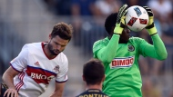 Philadelphia Union goalkeeper Andre Blake, right, makes a save over Toronto FC's Drew Moor during the first half of an MLS soccer match on Saturday, Aug. 20, 2016, in Chester, Pa. (AP Photo/Michael Perez)