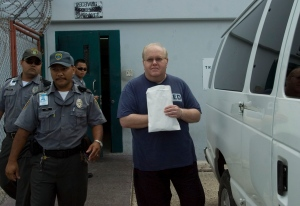 In this June 15, 2007, file photo, Lou Pearlman, right, is escorted to an awaiting van in Yigo, Guam. (Masako Watanabe/The Pacific Daily via AP, File)