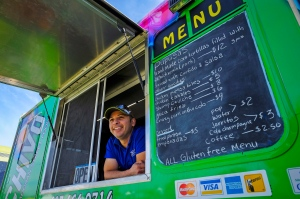 Emmanuel Guardado, who owns the QueChivo Salvadoran food truck, with his vehicle at a park in Calgary, Alta., Friday, Aug. 19, 2016. Guardado had always dreamed of starting his own food business, but it was only when he lost his job in the oil and gas industry that he decided to dive in. THE CANADIAN PRESS/Jeff McIntosh