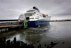 n this June 2, 2015 photograph, the Nova Star ferry arrives at the dock in Portland, Maine. Coastal hubs throughout New England increasingly rely on summer tourists to keep the ports busy as they strike a balance between tourism and traditional marine industry. (Derek Davis/Portland Press Herald via AP)