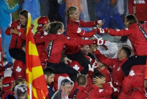 Athletes are carried on the shoulders of teammates of the Canadian team as they march in during the closing ceremony in the Maracana stadium at the 2016 Summer Olympics in Rio de Janeiro, Brazil, Sunday, Aug. 21, 2016. (AP Photo/Natacha Pisarenko)