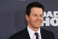 "FILE - In this Dec. 13, 2015 file photo, Mark Wahlberg attends the premiere of ""Daddy's Home"" in New York. Jackie Becker and her mother, Jean, found out Wahlberg was shooting scenes for the upcoming film ""Patriots Day"" in their suburban Boston hometown of Framingham, they delivered pizza and cookies to the set. (Photo by Charles Sykes/Invision/AP"