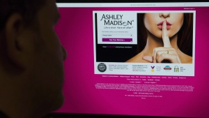 A man looks at the Ashley Madison website in this photo illustration in Toronto on Thursday, August 20, 2015. THE CANADIAN PRESS/Graeme Roy