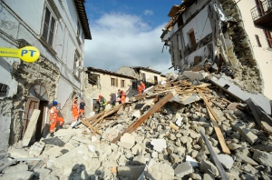 A man is carried on a stretcher after being rescued following an earthquake in Arquata del Tronto, Italy, Wednesday, Aug. 24, 2016. The magnitude 6 quake struck at 3:36 a.m. (0136 GMT) and was felt across a broad swath of central Italy, including Rome where residents of the capital felt a long swaying followed by aftershocks. (AP Photo/Sandro Perozzi)
