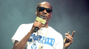 """FILE - In this Aug. 5, 2016 file photo, Snoop Dogg performs during his """"The High Road Tour"""" at the BB&T Pavilion in Camden, N.J. A lawyer representing 17 people injured when a railing collapsed at the Aug. 5, concert is suing the performers and the venue's owner. (Photo by Owen Sweeney/Invision/AP, File)"""