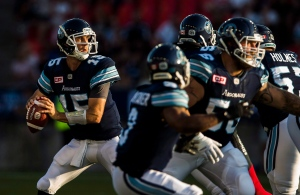 Toronto Argonauts quarterback Ricky Ray scrambles against the Ottawa Redblacks during the first half of CFL football action in Toronto on Wednesday, July 13, 2016. (The Canadian Press/Mark Blinch)