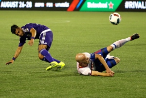 Orlando City's Matias Perez Garcia, left, and Toronto FC's Michael Bradley collide while trying to get possession of the ball during the first half of an MLS soccer game on Wednesday, Aug. 24, 2016, in Orlando, Fla. (AP Photo/John Raoux)
