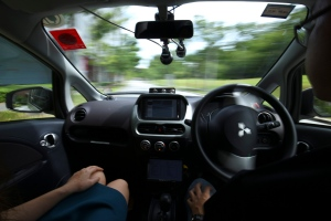 A driver, right, gets his hands off of the steering wheel of an autonomous vehicle during its test drive in Singapore Wednesday, Aug. 24, 2016. The world's first self-driving taxis, operated by nuTonomy, an autonomous vehicle software startup, will be picking up passengers in Singapore starting Thursday, Aug. 25. The service will start small - six cars now, growing to a dozen by the end of the year. (AP Photo/Yong Teck Lim)