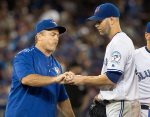 Toronto Blue Jays manager John Gibbons takes the ball from starting pitcher J.A. Happ during the sixth inning of their American League MLB baseball game against the Los Angeles Angels in Toronto on Thursday, Aug. 25, 2016. (The Canadian Press/Fred Thornhill)