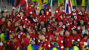 Athletes from Canada march into the stadium during the closing ceremony at the 2016 Olympic Games in Rio De Janerio, Brazil on Aug. 21, 2016 (Gary Hershorn/SilverHub)