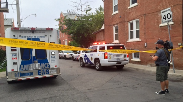 Paramedics and police are seen in Riverdale where a woman was shot dead on Aug. 27. (Christina Tenaglia/CP24)