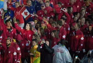 Penny Oleksiak carries a smaller flag and walks with her teammates into the closing ceremonies of the Olympic games in Rio de Janeiro, Brazil, Sunday, August 21, 2016. (The Canadian Press)