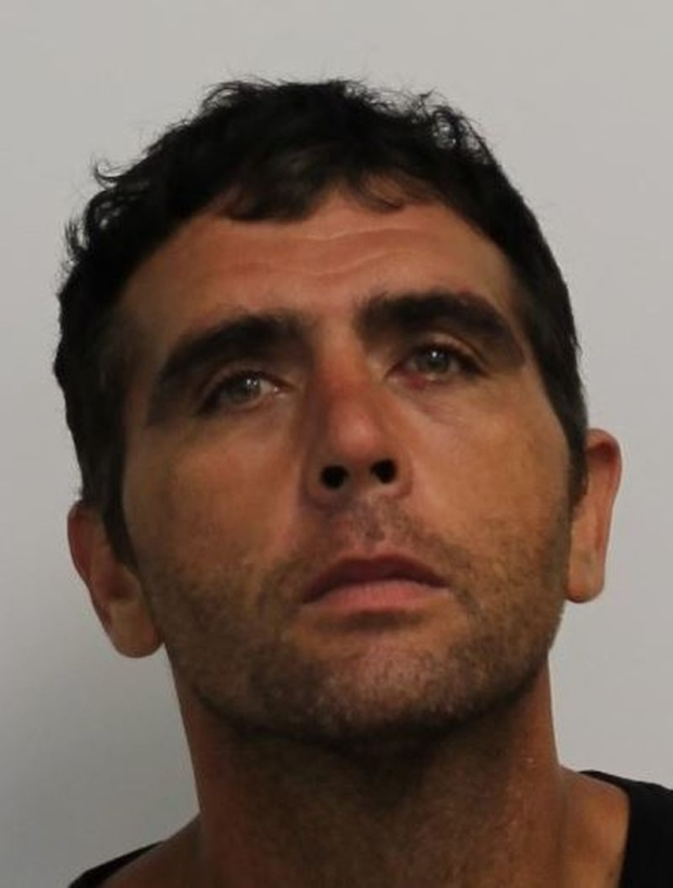 Kevin Sampson, 40, is shown in this handout photo. Sampson is facing a  number of fraud and extortion related charges. (Toronto Police Service)