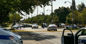 A police cruiser (centre) that reportedly struck an officer on Mississauga Road in Mississauga is shown. (Pascal Marchand)