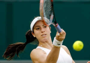 In this Friday, July 1, 2016, file photo, Christina McHale of the United States, returns to Serena Williams, of the United States, during their women's singles match on day five of the Wimbledon Tennis Championships in London. McHale won a first-set tiebreaker against her idol Williams at Wimbledon last month, she's played in three tournaments and World Team Tennis to prepare for the U.S. Open. Before considering a rematch, the New Jersey native needs to get past first-round opponent Mona Barthel of Germany on Monday, Aug. 29. (AP Photo/Ben Curtis, File)