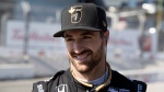 Schmidt Peterson Motorsports driver James Hinchcliffe, of Canada, smiles as he prepares for practice sessions at the Honda Toronto Indy in Toronto, Friday July 15, 2016. THE CANADIAN PRESS/Mark Blinch