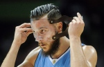 Denver Nuggets center Joffrey Lauvergne, of France, puts on his face guard after a timeout during the second half of an NBA basketball game against the Atlanta Hawks, Thursday, March 17, 2016, in Atlanta. (AP Photo/John Amis)