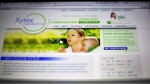 This Friday, April 17, 2015 photo shows the website of Xytex Cryo International sperm bank in Atlanta. Angela Collins and Margaret Elizabeth Hanson say they chose Donor 9623 to be the father of their child because his profile said he was eloquent, mature, healthy and smart to boot. But then last June, just under seven years after Collins gave birth to a son conceived with his sperm, they learned the previously anonymous sperm donor's name and quickly discovered he is schizophrenic, dropped out of college and had been arrested for burglary, they said in a lawsuit filed March 31 in Fulton County Superior Court in Atlanta. The women, who live in Canada, sued Xytex Corporation, its parent company, sperm bank employees and the man they say was the misrepresented donor. (AP Photo/David Goldman)