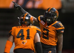 B.C. Lions' Chris Rainey, right, celebrates his 72 yard punt return touchdown with teammate Adrian Clarke during the second half of a CFL football game against the Calgary Stampeders in Vancouver, B.C., on Saturday, June 25, 2016. (The Canadian Press/Darryl Dyck)