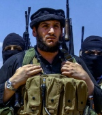 This undated image posted online Wednesday, Aug. 31, 2016, by supporters of the Islamic State group on an anonymous photo sharing website, shows Abu Muhammed al-Adnani, IS's spokesman and chief strategist.  (Militant Photo via AP)
