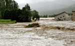 Floodwaters from the Sorachi river wash away a building after embankments of the river were broken in Minami-furano, the northern island of Hokkaido, Japan, Wednesday, Aug. 31, 2016. At least two rivers swollen by Typhoon Lionrock broke through embankments, flooding the areas. (Risa Ominato/Kyodo News via AP)