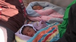 In this frame grab taken Monday, Aug. 29, 2016 from video, 5-day-old twins from Eritrea, who were born prematurely in Libya, are seen after being rescued from the Mediterranean Sea by members of two NGO's and the Italian navy. The two Eritrean babies are being treated at a hospital in Palermo after being rescued at sea along with thousands of other migrants. (AP Photo)