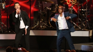 """In this Dec. 6, 2013, file photo, Robin Thicke, left, and T.I. perform """"Blurred Lines"""" at the Grammy Nominations Concert Live! at the Nokia Theatre L.A. Live in Los Angeles. More than 200 musicians filed a brief with the Ninth Circuit Court of Appeals on Tuesday, Aug. 30, 2016, to express concern about the ruling last year in a case brought by the children of Marvin Gaye, who sued for copyright infringement claiming """"Blurred Lines"""" copied Gaye's hit """"Got to Give it Up.""""  (Photo by Matt Sayles/Invision/AP, File)"""