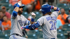 Toronto Blue Jays' Jose Bautista, left, celebrates his solo home run with teammate Josh Donaldson during the first inning of a baseball game against the Baltimore Orioles in Baltimore, Wednesday, Aug. 31, 2016. (AP Photo/Patrick Semansky)