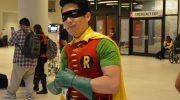 A man dressed as Robin from 'Batman' strikes a pose on the floor of Fan Expo Canada in downtown Toronto Saturday, September 3, 2016. (Joshua Freeman /CP24)