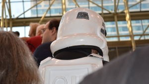 A fan dressed as a storm trooper from 'Star Wars rides the escalator at Fan Expo Canada in downtown Toronto Saturday, September 3, 2016. (Joshua Freeman /CP24)